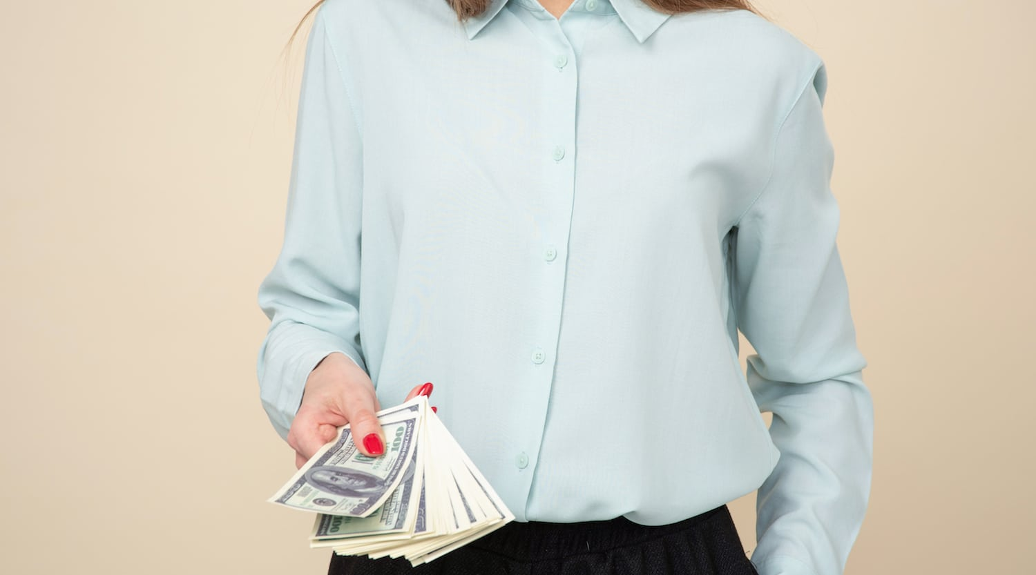 Woman holding dollars
